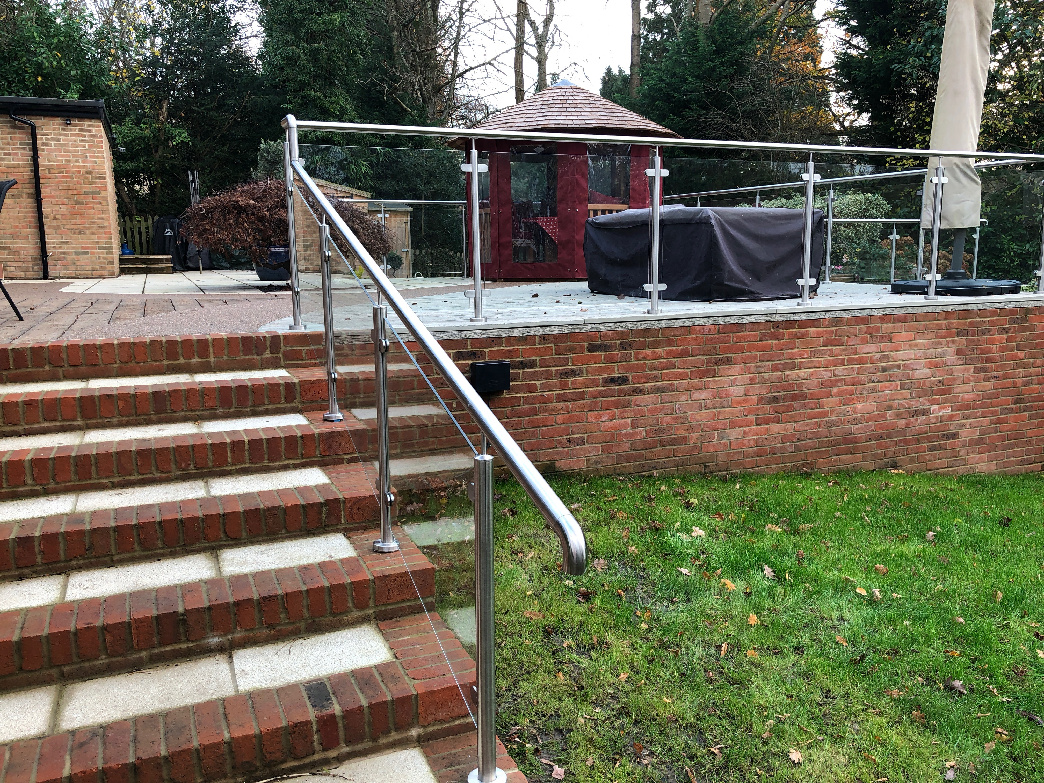 Glass balustrade on raised patio
