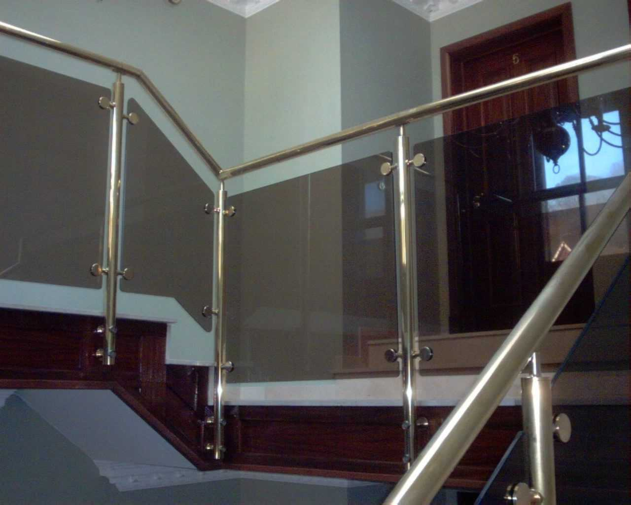 brass handrail with glass baluster