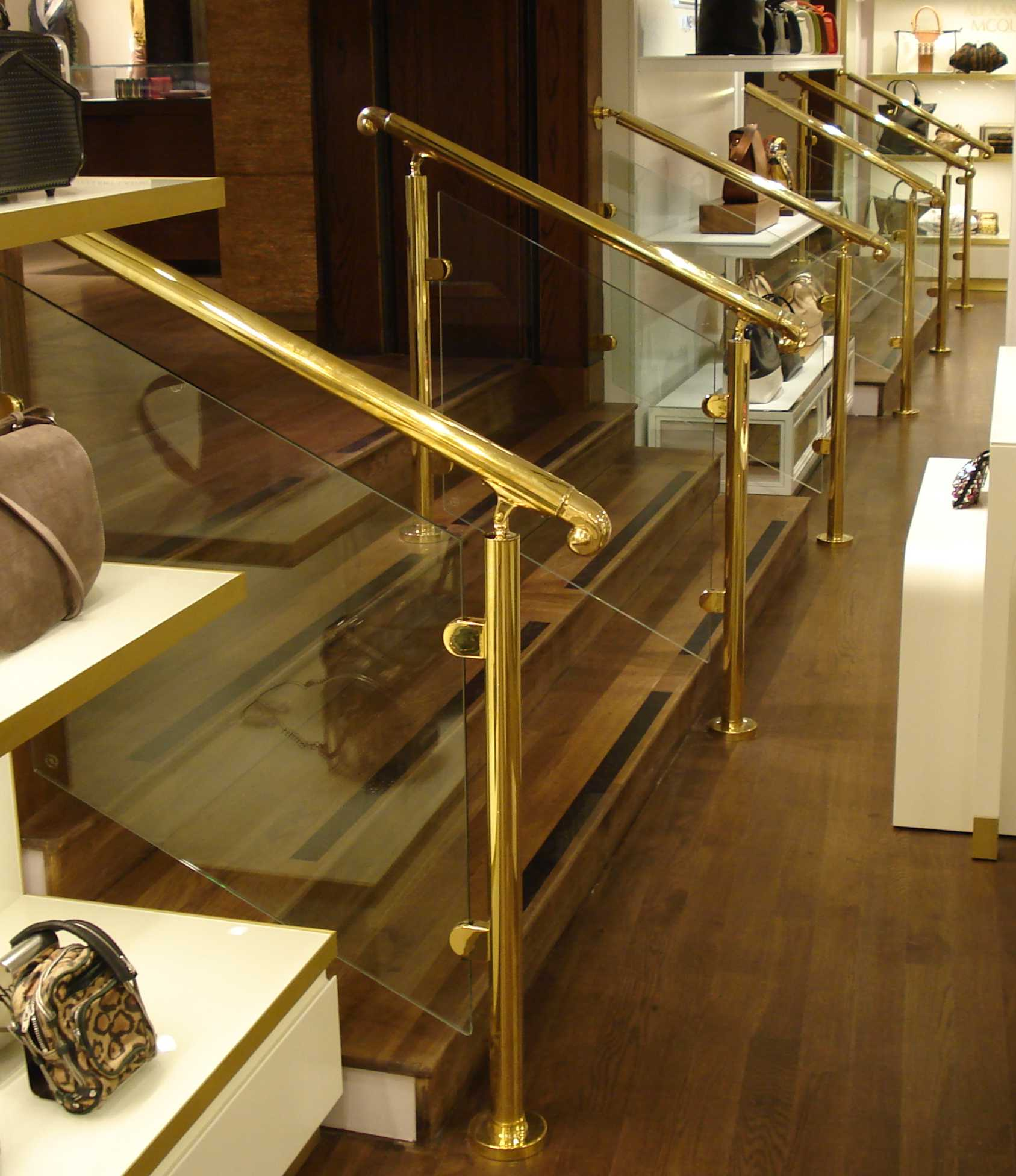 line of brass step handrails