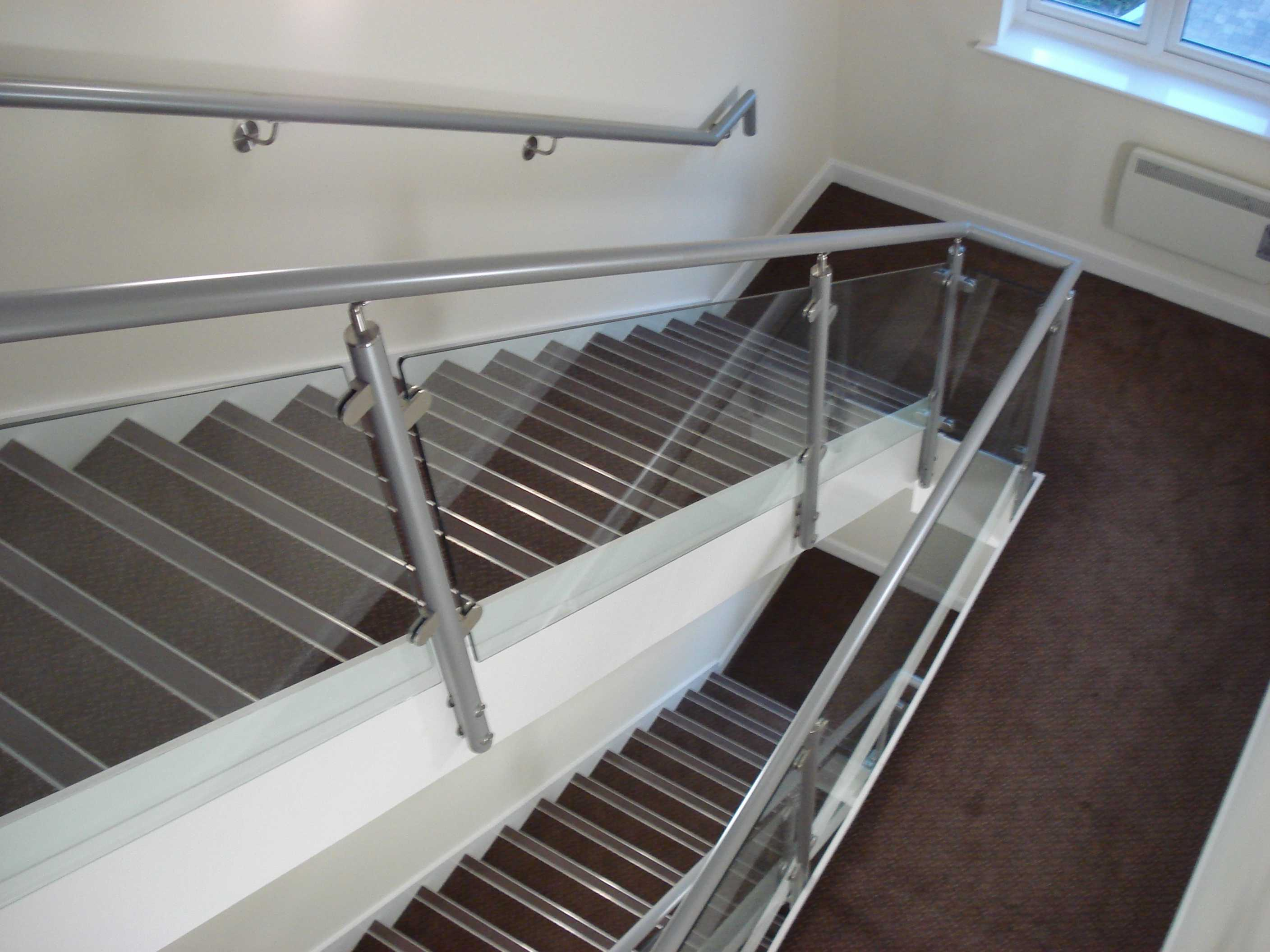 Staircase with aluminium handrail