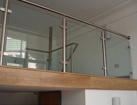 stainless steel handrail and posts with glass infill panels