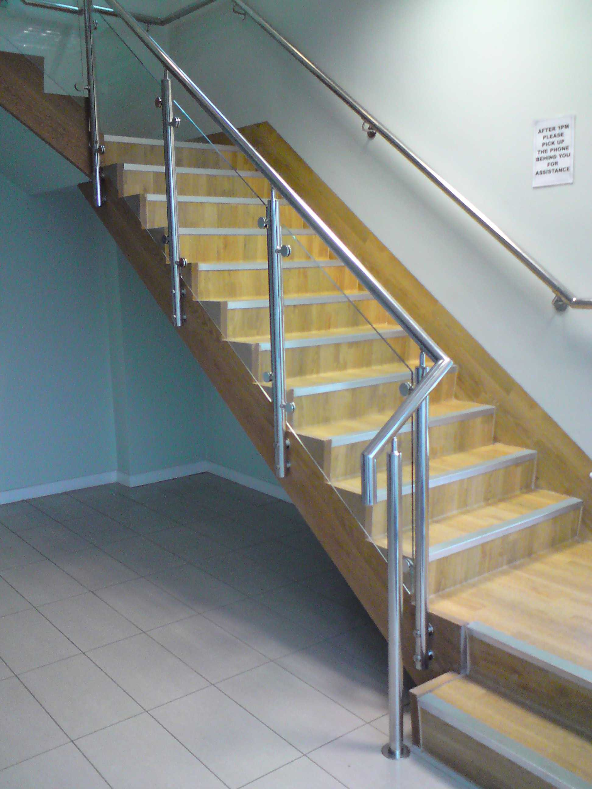 staircase with glass infill and stainless steel handrail