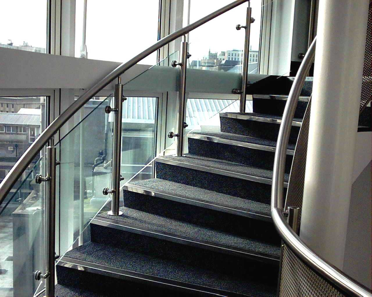 sweeping stainless steel handrail on staircase