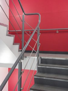 warm to touch handrail on staircase with red wall