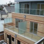 Glass balustrade with stainless steel handrail