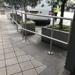 Stainless steel handrail outside of shops