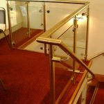 Brass handrail over staircase