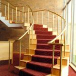 Prestigious staircase with brass handrail