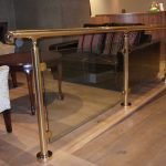 Brass handrail with glass balustrade
