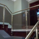 Brass handrail with glass infill