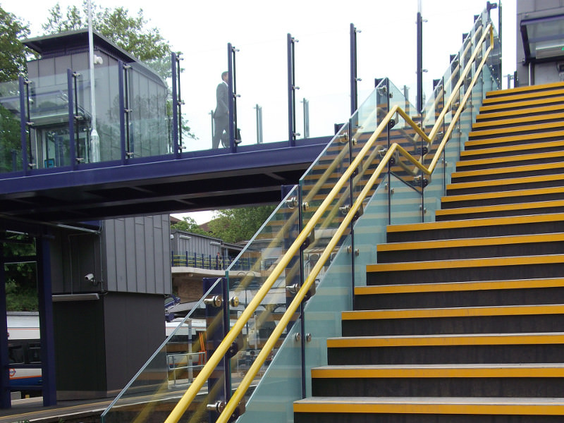 Handrail and balustrade for railway footbridge