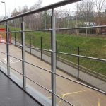 External stainless steel handrail with wire infill