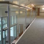 Stainless steel handrail with glass infill