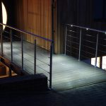 Illuminated handrail on bridge at night
