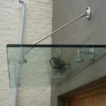 Glass suspended door canopy