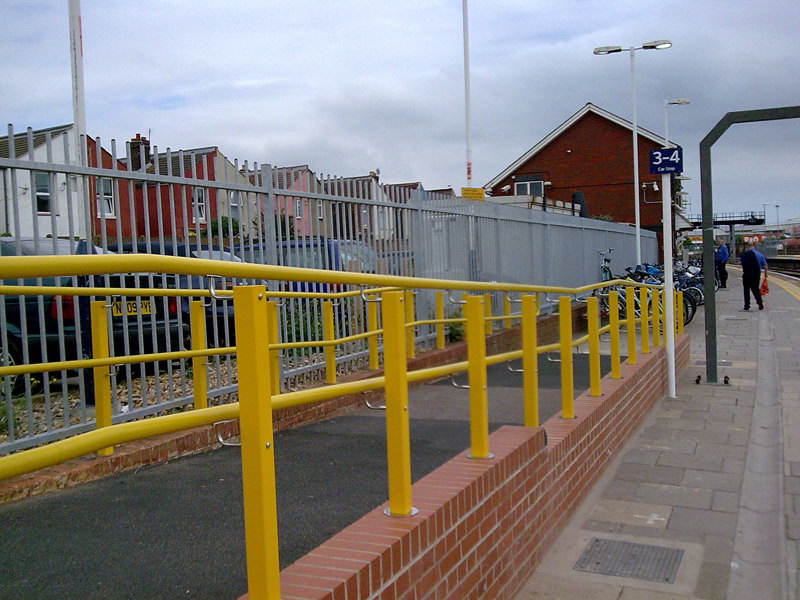 Yellow external handrail at railway