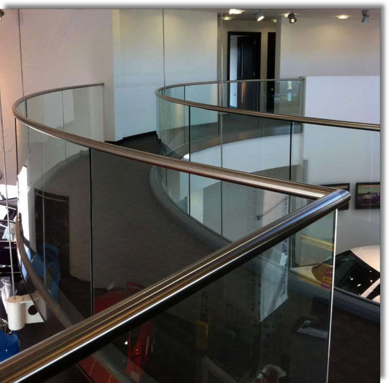 Curved handrail with glass balustrade