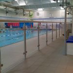 Glazed balustrade at public swimming pool