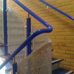 Blue DDA handrail with perforated infill